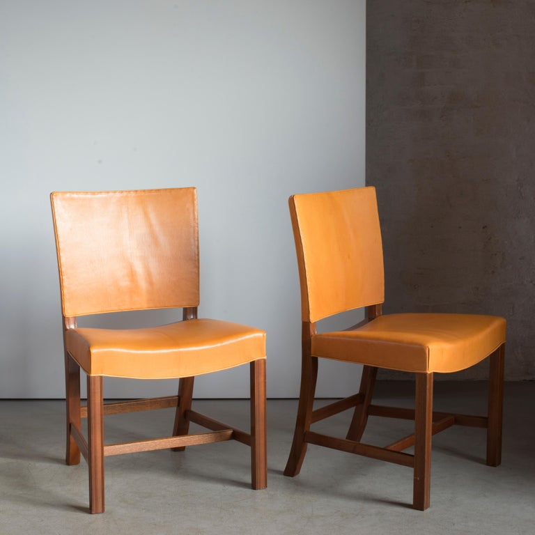 Kaare Klint pair of red chairs, mahogany, leather and brass. Executed by Rud. Rasmussen.