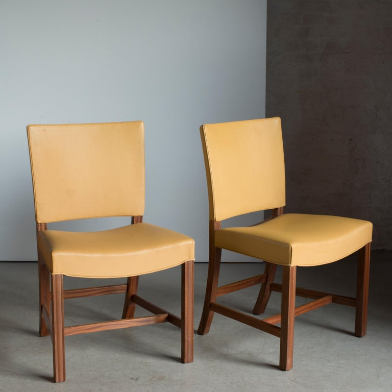 Kaare Klint pair of red chairs, mahogany and leather. Executed by Rud. Rasmussen.