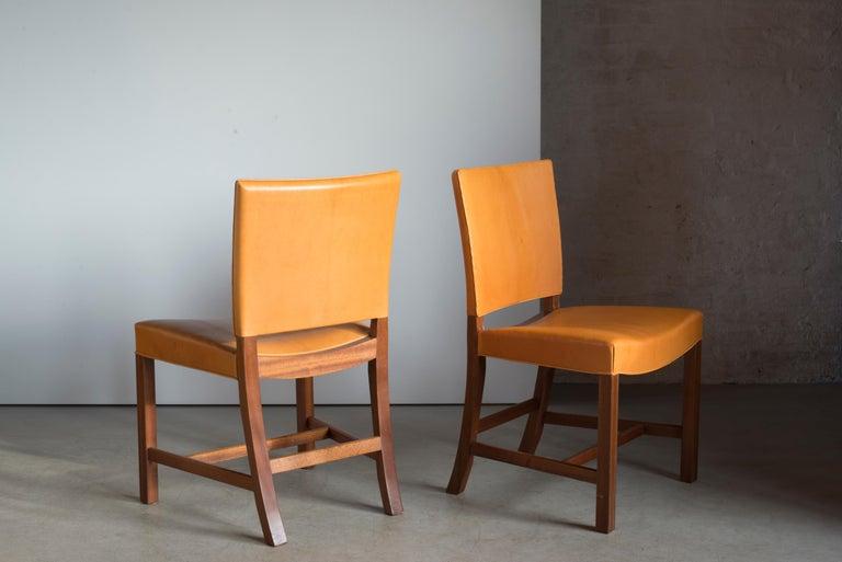 Scandinavian Modern Kaare Klint Pair of Red Chairs for Rud Rasmussen For Sale