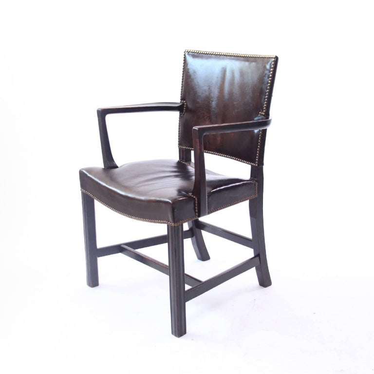 Kaare Klint & Rud RasmussenSnedkerier - Scandinavian Modern  Kaare Klint model no. 3758A. 'Red Armchair' / 'Barcelona Chair' in dark brown leather, dark stained oak frame with profiled legs and brass nails.   Designed, 1930.  Executed by