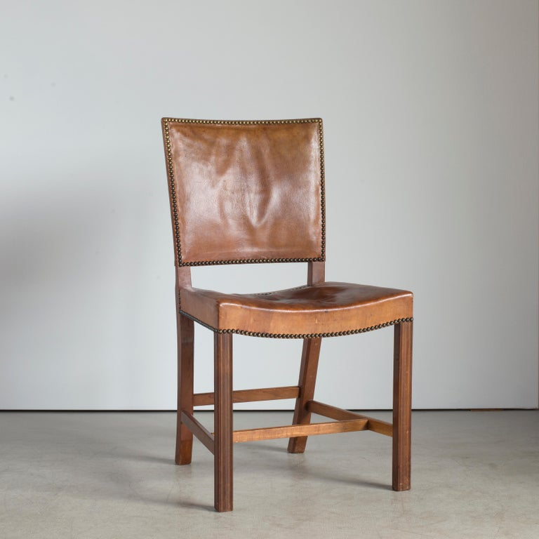 Kaare Klint red chair. Executed by Rud. Rasmussen.  Cuban mahogany, Niger leather and brass nails.   Underside with manufacturer's paper label RUD. RASMUSSENS/SNEDKERIER/45 NØRREBROGAD/KØBENHAVN, pencilled number and architect's monogrammed