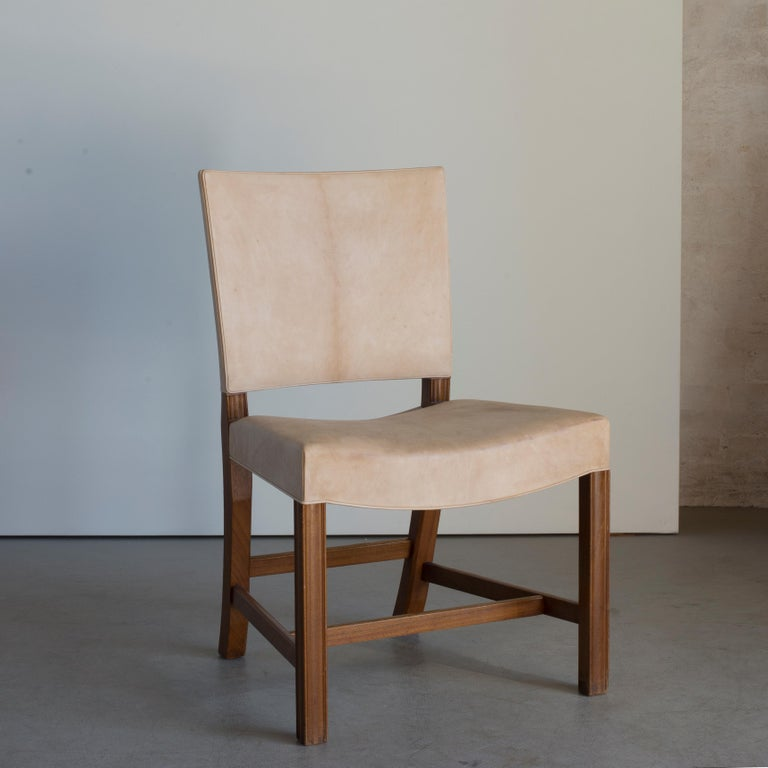 Kaare Klint 'Red Chair' of mahogany and Niger leather. Executed by Rud. Rasmussen.  Underside with manufacturer's paper label RUD. RASMUSSENS/SNEDKERIER/45 NØRREBROGAD/KØBENHAVN, penciled number and architect's monogrammed paper label.