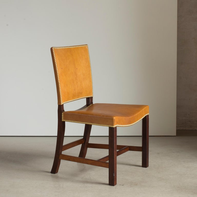Kaare Klint red chair in Cuban mahogany, Nigerian leather and brass nails. Executed for the Danish Chamber of Commerce by C. B. Hansen in 1928.