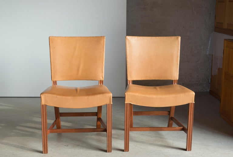 Kaare Klint set of four red chairs in mahogany and leather. Executed by Rud. Rasmussen.