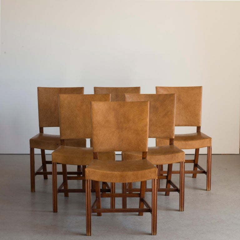 Kaare Klint set of six red chairs. Executed by Rud. Rasmussen, 1930-1934  Cuban mahogany and Niger leather.  Underside with manufacturer's paper label RUD. RASMUSSENS/SNEDKERIER/45 NØRREBROGAD/KØBENHAVN, penciled number and architect's
