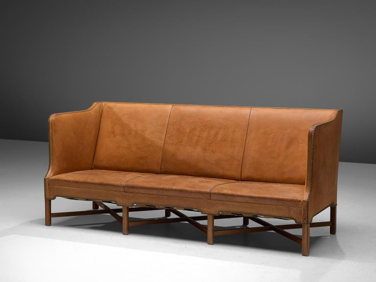 Kaare Klint for Rud Rasmussen, sofa model 4118, original leather and mahogany, Denmark, 1929.  Classic and elegant Scandinavian three-seat sofa model 4118 by Kaare Klint. This model was designed in 1929. The base consists of eight legs in mahogany