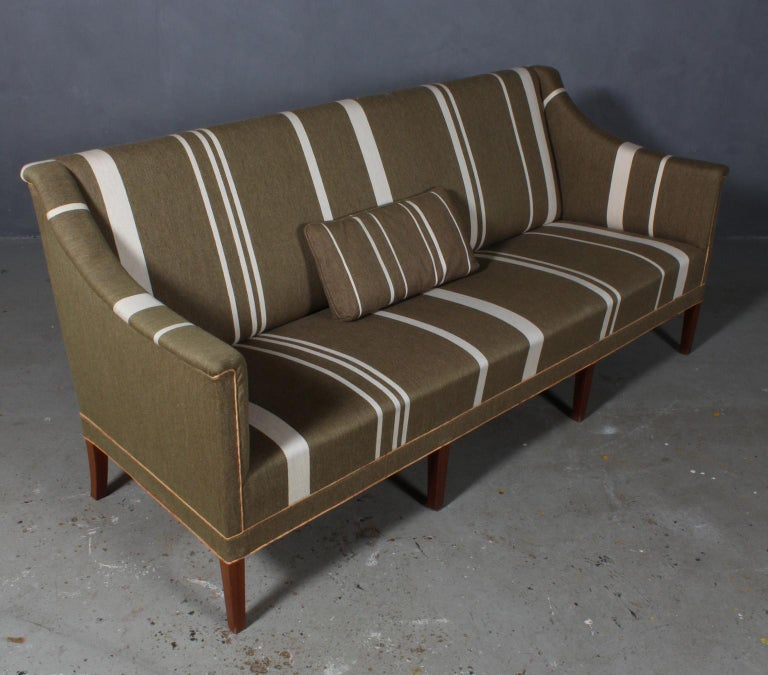 Kaare Klint sofa in green wool with white stripes. 