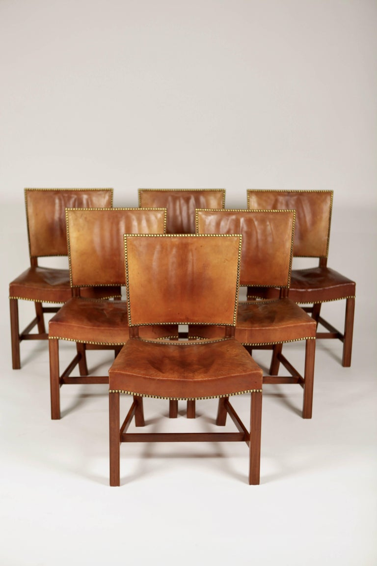 Kaare Klint, A set of six 'Barcelona' dining chairs. Designed 1927 This set is manufactured 1932, in original, excellent condition, made of Cuban mahogany, Niger leather and brass nails. Model 3758. Executed by cabinetmakers Rud. Rasmussen A/S,