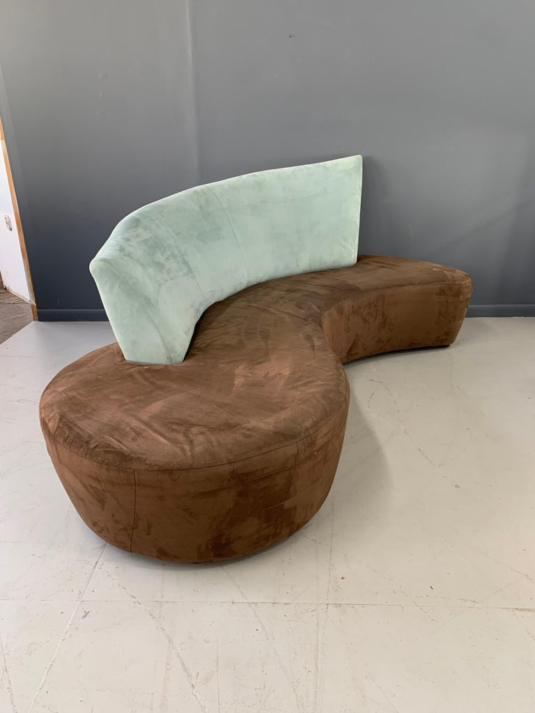 This sofa has a wonderful Postmodern look.  The fabric on this sofa is worn and re-upholstery is warranted, ship us your fabric and we will upholster this sofa for $750.