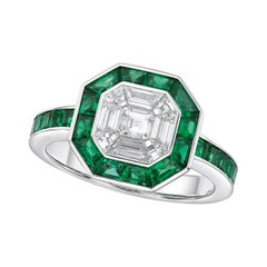 Kahn 18 Karat Llusion White Diamond Ring with Emerald Halo
