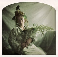 Queen Charlotte: Portrait Photograph of Woman in Green Holding Bouquet and Birds