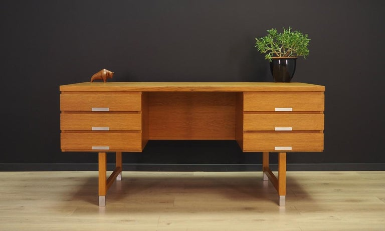 Unique desk from the 1960s-1970s. Design by prominent Danish designer Kai Kristiansen. The surface of the furniture is finished with ash veneer, legs are made of solid ash wood. The desk has six practical drawers with brilliant metal handles,