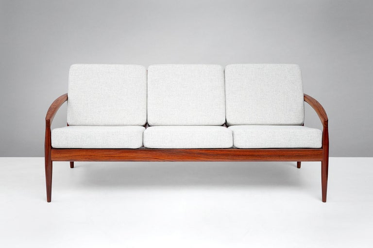 Kai Kristiansen.  Paper Knife sofa, 1955.  Produced by Magnus Olesen, Denmark. Rarely seen example of the three person sofa made from rosewood. New cushions covered in Kvadrat Tonica wool fabric.