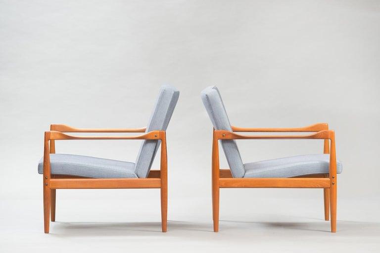 Pair of midcentury teak lounge chairs reupholstered in velvet.