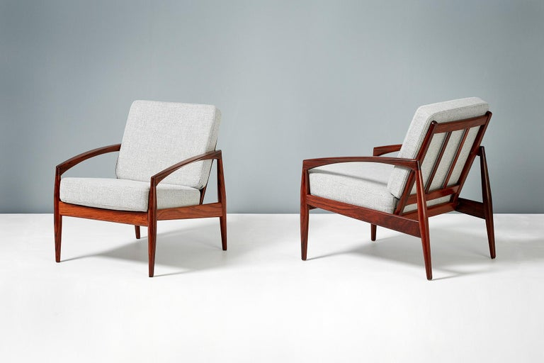 Kai Kristiansen  Pair of paper knife model lounge chairs, 1955.  Produced by Magnus Olesen, Denmark in rosewood. New cushions upholstered in soft grey wool fabric.