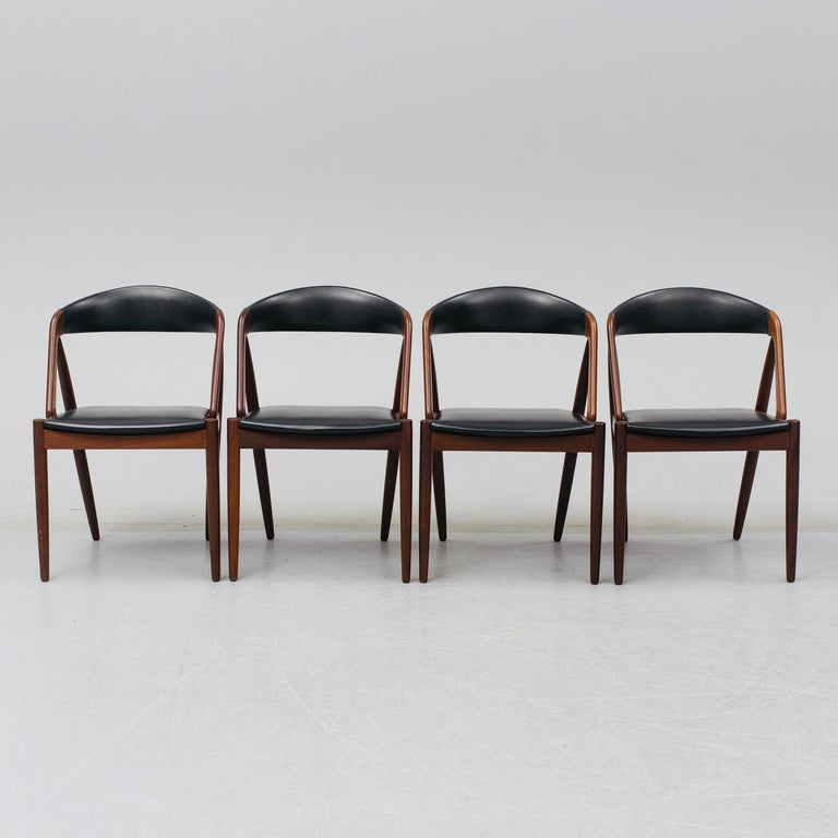 Set of four Kai Kristiansen mahogany dining chairs model 31 also called 'Pige Chairs'. Produced by Schoe Anderson in Denmark in the early 1960s.
