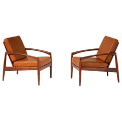Kai Kristiansen Rosewood Lounge Chairs with Cognac Leather Cushions