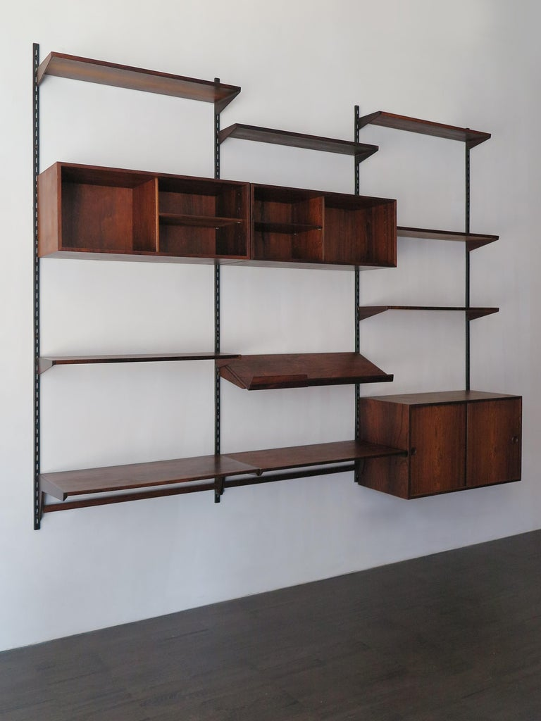 Scandinavian dark wood shelving system designed by Danish designer Kai Kristiansen for FM Mobler, wood box and shelves can be positioned as desired; manufacture label., circa 1960.  Please note that the item is original of the period and this