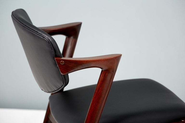 Scandinavian Modern Kai Kristiansen Set of 8 Model 42 Dining Chairs, Rosewood and Leather For Sale