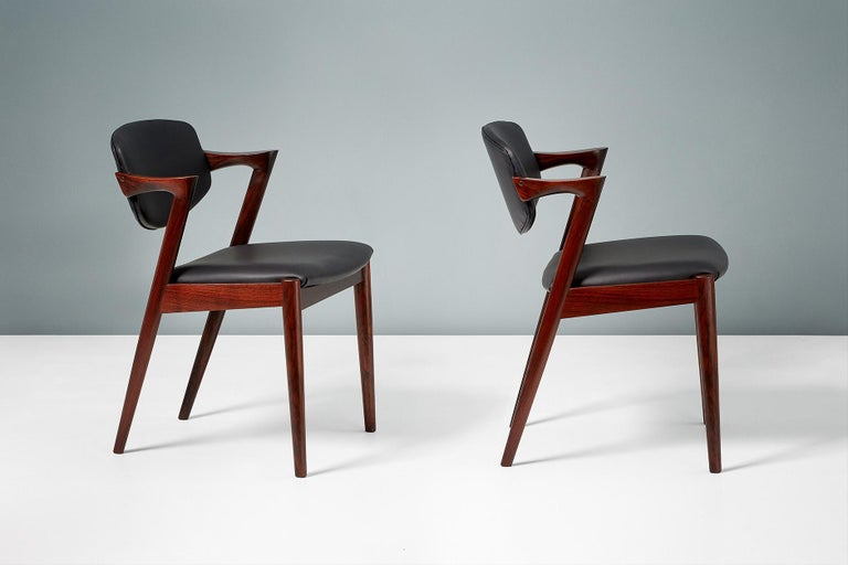 Mid-20th Century Kai Kristiansen Set of 8 Model 42 Dining Chairs, Rosewood and Leather For Sale