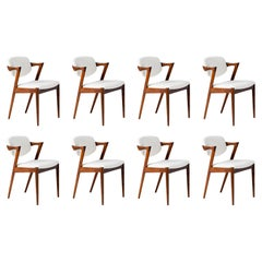 Kai Kristiansen Set of 8 Model 42 Rosewood and Boucle Dining Chairs