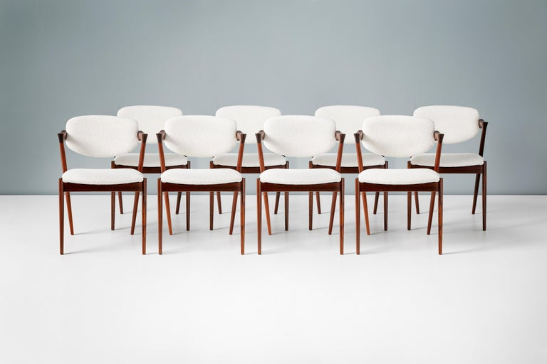 Kai Kristiansen Model 42 dining chairs, 1956.  Set of 8 dining chairs produced by Skovman Andersen for the Illum Bolighus department store in Copenhagen. The frames are made from the highest quality Brazilian rosewood which have been