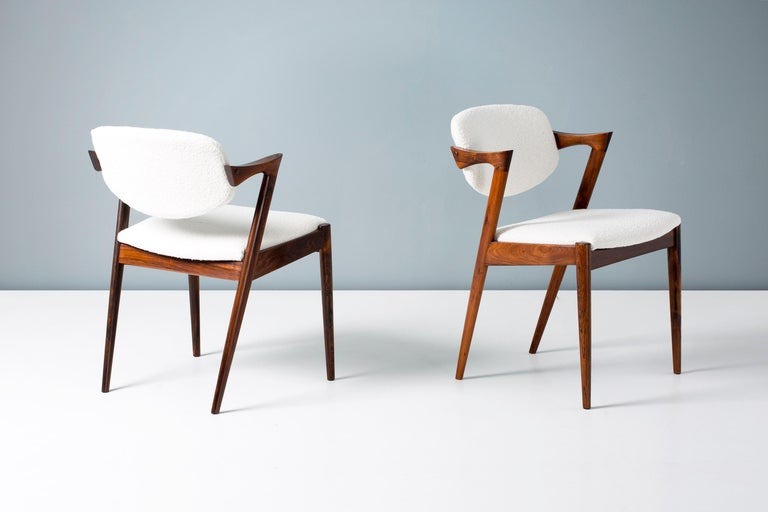Scandinavian Modern Kai Kristiansen Set of 8 Model 42 Rosewood and Boucle Dining Chairs For Sale