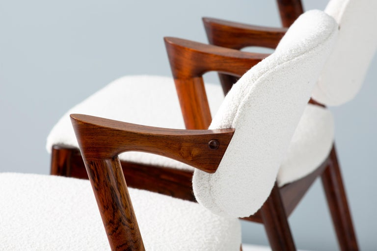 Danish Kai Kristiansen Set of 8 Model 42 Rosewood and Boucle Dining Chairs For Sale