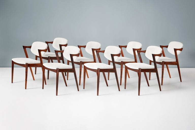 Kai Kristiansen Set of 8 Model 42 Rosewood and Boucle Dining Chairs For Sale 1