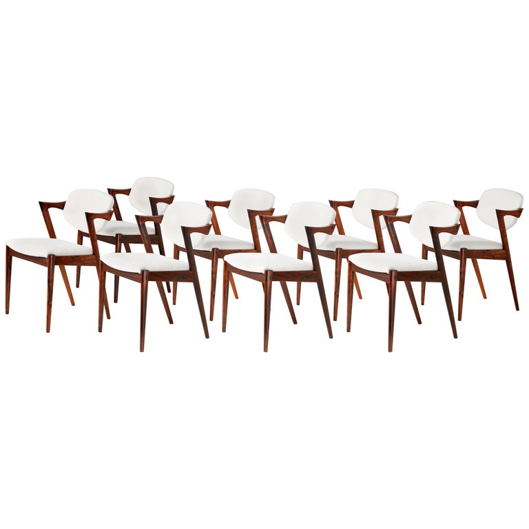 Kai Kristiansen Set of 8 Model 42 Rosewood and Boucle Dining Chairs For Sale