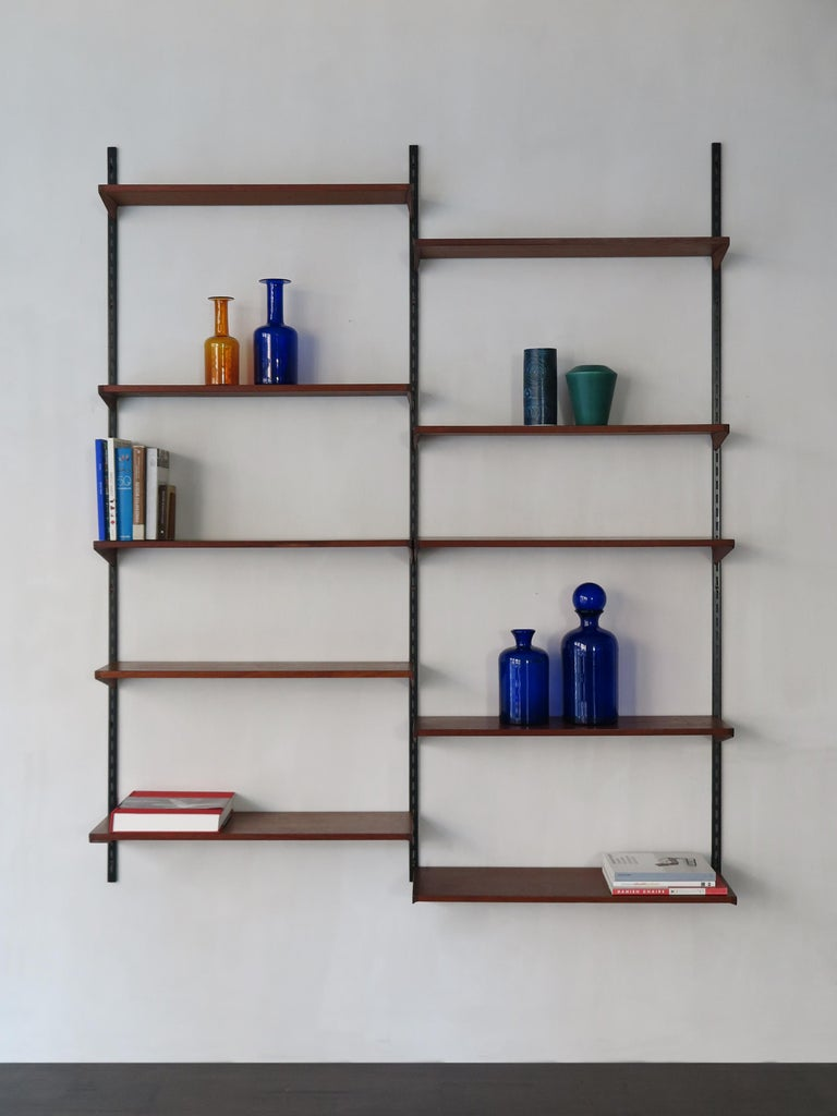 Scandinavian Mid-Century Modern design teak shelving system designed by Kai Kristiansen for FM Mobler Denmark, shelves can be positioned as desired, circa 1960.