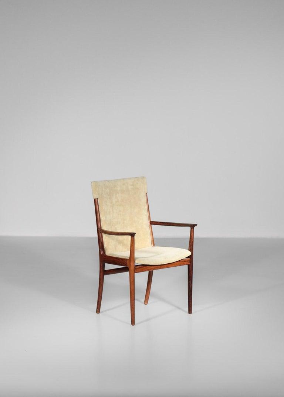 Rare Danish armchair by designer Harry in rosewood. Seat in cream fabric. Soren Willadsen Mobelfabrik.
