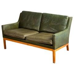 Kai Lyngfeldt Larsen Loveseat in Teak + Original Green Leather