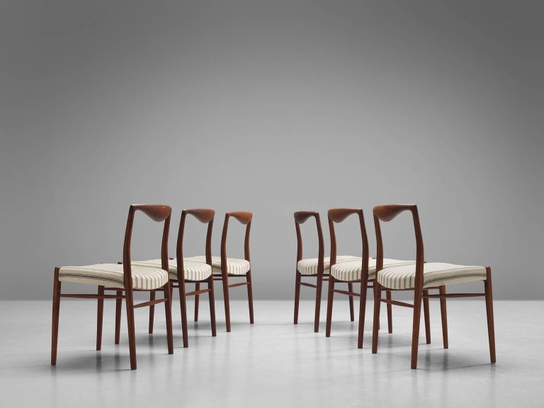 Kai Lyngfeldt Larsen for Soren Willadsen, set of six dining chairs in teak and white to beige fabric, Denmark, 1960s.  These elegant, curvy dining chairs show wonderful craftsmanship. The top rail is formed by a sculptural piece of soft teak that
