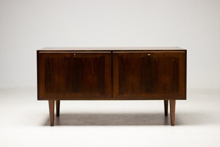 Rosewood sideboard designed by Kai Winding, produced by Poul Jeppesens Møbelfabrik. The piece has 2 drawers with an opening, suitable for high end stereo equipment. Marked with label.