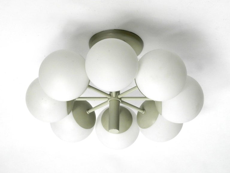 Beautiful Kaiser ceiling lamp with 8 opaline glass balls in light gray. Elegant 1960s Space Age Atomic Design. Very good vintage condition without damages. Very few signs of wear. 100% original condition and fully functional. Eight E14 sockets