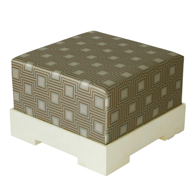 Sophisticated and stylish, the Square Kajal Pouf features a sturdy wooden base covered with matte natural colored parchment and is beautifully complimented by the padded seat upholstered in an elegant fabric of optimal quality. Comfortable and