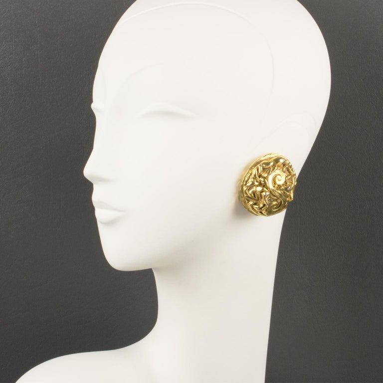 Stunning Kalinger Paris oversized clip-on earrings. Round-domed shape featuring a large gilt-metal coated cameo with intricately carved design. Marked on the clip:
