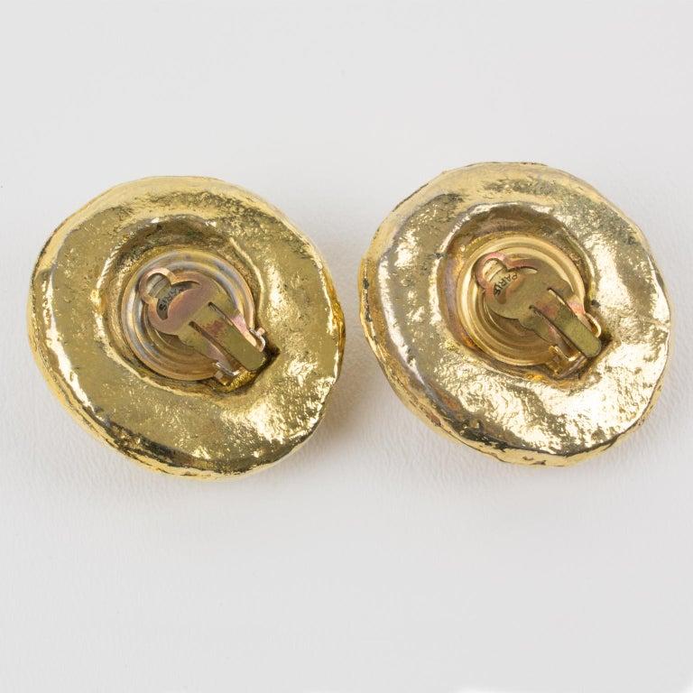 Women's or Men's Kalinger Oversized Carved Gilt Resin Clip Earrings For Sale