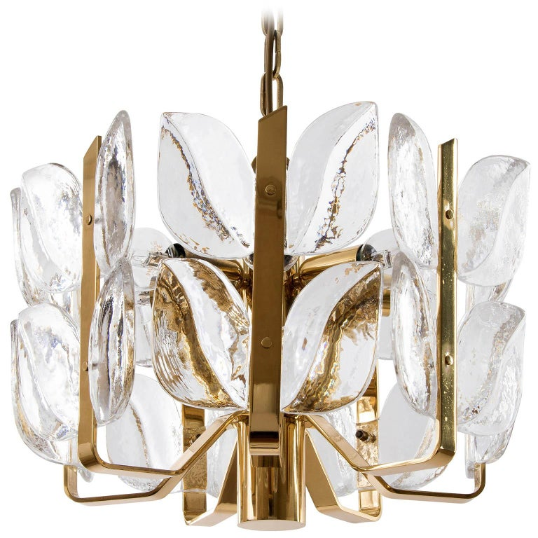 A rare and handmade high quality pendant light fixture model 'Florida' by J.T. Kalmar, Austria, manufactured in midcentury, circa 1970 (late 1960s or early 1970s). The lamp is made of polished brass and large fire-polished brilliant crystal glasses