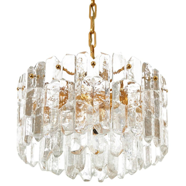 A very exquisite 24-carat gold-plated brass and clear brillant glass Hollywood Regency light fixture model 'Palazzo' by J.T. Kalmar, Vienna, Austria, manufactured in midcentury, circa 1970 (late 1960s or early 1970s). The lamp is marked with a