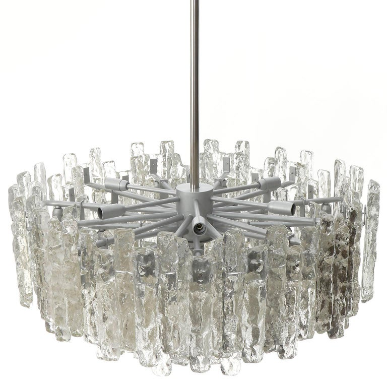 One of three extra large light fixtures model 'Soria' by Kalmar, Austria, manufactured in midcentury, circa 1970 (late 1960s or early 1970s).  The offered chandeliers are the largest version of the 'Soria' series from Kalmar. They have been