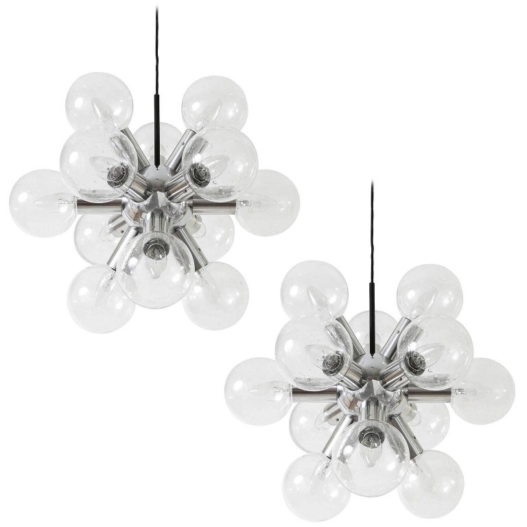 One of two rare and fantastic 12-arm atomic chandeliers / pendant lights model