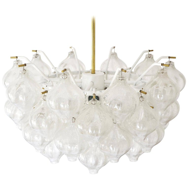 A fantastic light fixture model Tulipan by J.T. Kalmar, Vienna, Austria, manufactured in midcentury, circa 1970 (late 1960s or early 1970s). The name Tulipan derives from the tulip shaped hand blown bubble glasses. Each glass is handmade and