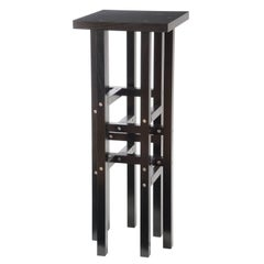 Modern Pedestal Table with Industrial Metal and Geometric Black Wood