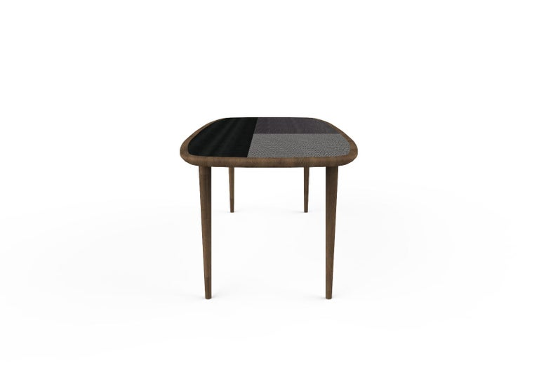 Dinner table in walnut Canaletto and legs in solid walnut Canaletto walnut and top in fabric-effect wood finish. The top can be made in one single finish or with contrasting background.