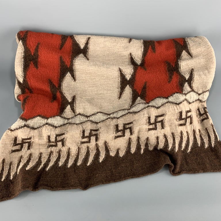 KAPITAL scarf comes in beige wool jersey knit with a brown and orange pattern throughout and Buddhist peace sign print trim. Made in Japan.  New with Tags.   96 x 27 in.
