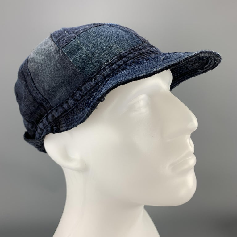 KAPITAL hat comes in light weight indago denim blue linen with patchwork throughout, quilted brim, and buttoned back detail. Made in Japan.  New with Tags.  Measurements:  Opening: 24 in. Brim: 3 in. Height: 5 in.