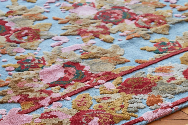 Designed by Jan Kath, this hand-knotted rug is from a collection inspired by carpets made in Karabagh and other provinces in southern Russia circa 1900. The patterns are created using rich, bright colors of Tibetan highland wool and Chinese silk,