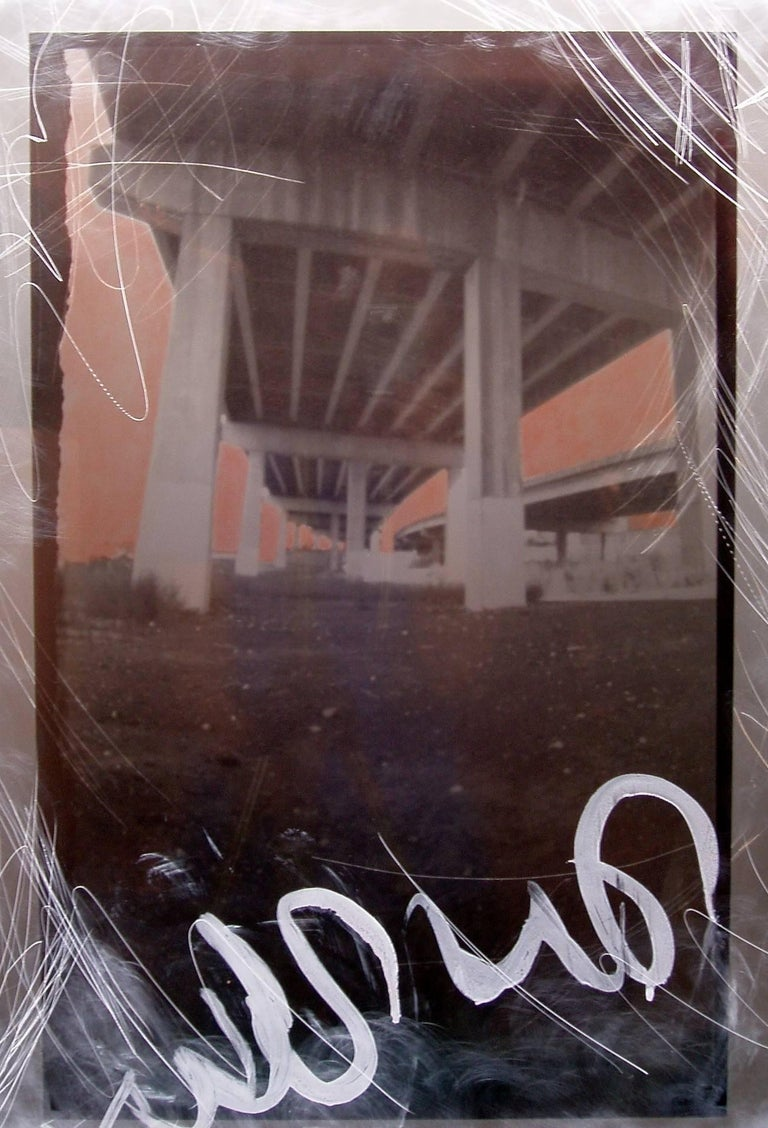 Large archival transparency made from pinhole photos taken of urban vistas under the expressway, encased in clear Lucite panels with added fluorescent lighting and stainless steel hardware. The massive columns of the expressway contrast with weeds